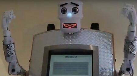 This robot priest delivers automated blessings at a German church