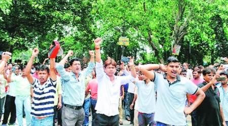 Agitation at textile mill: Workers 'block' mill official's car, says police shot atthem
