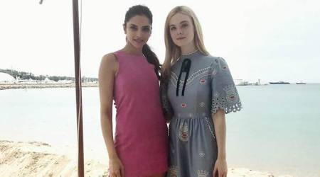 Cannes 2017: Deepika Padukone, Elle Fanning are enjoying a girl's day out at the beach. See photos, videos