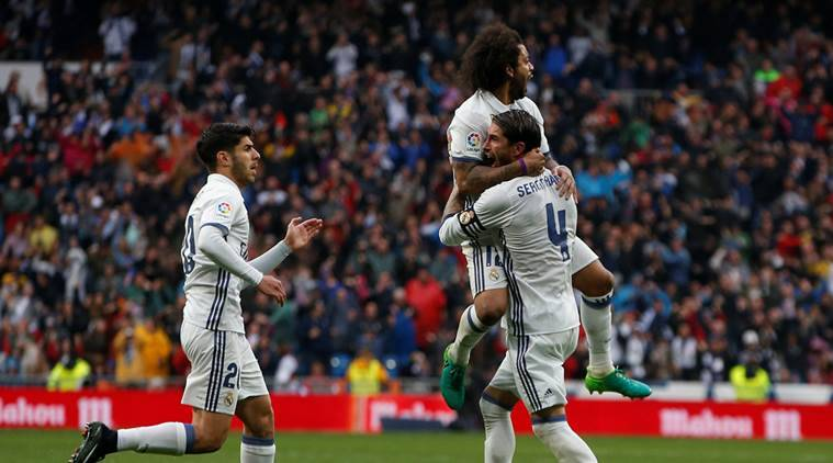 Marcelo rescues Real Madrid with victor against Valencia, Granada relegated