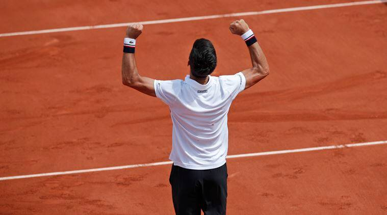 With Agassi along for a bit, Djokovic opens defense in Paris
