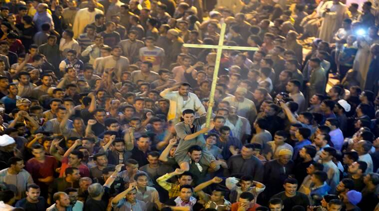 Coptic Christians, attacks in Egypt, unidentified gunmen, grief, rage, Christians, church bombings, violence against Copts, international news, indian express news