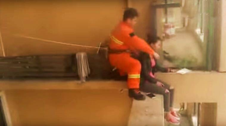 feel good videos, humanity videos, firefighter saves a woman from dying, indian express, indian expess news