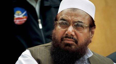 Pakistan EC warns candidate for using Hafiz Saeed's photo in campaign