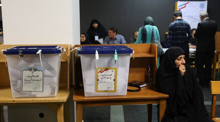 Iran counts votes after big turnout in presidential election