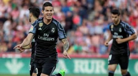 Rampant Real Madrid thrash Granada 4-0 to keep pressure onBarcelona