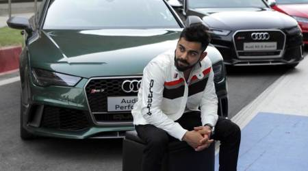 Virat Kohli test drives the new Audi Q7 at Buddha International circuit; see pics