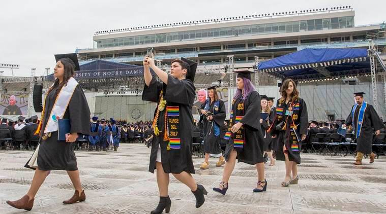 U.S. university graduates stage walk-out during Mike Pence speech
