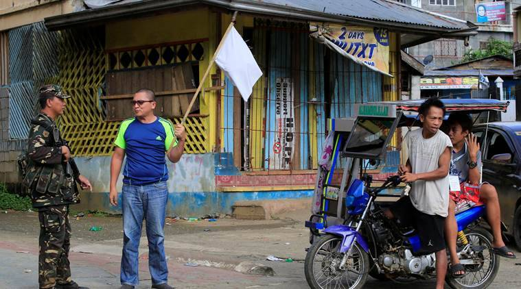 Philippine military, militants attacks, Islamic states group, martial law in south philippine, white flags by civilians, philippine news, world news, indian express news