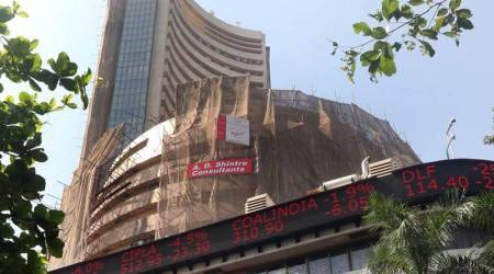 Spurred by Reliance Industries, Sensex climbs 124 pts; Nifty above 9,900