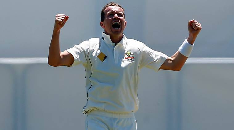 Australia's Peter Siddle celebrates after dismissing South Africa's Jean-Paul Duminy at the WACA Ground in Perth.