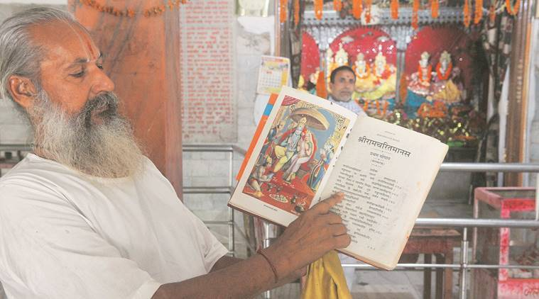 """Janki Sthan's Triloki Das. The temple draws more devotees than Punoura Dham, whose Kishore Das (right) says he is not bothered by what """"mortals"""" say. Santosh Singh"""