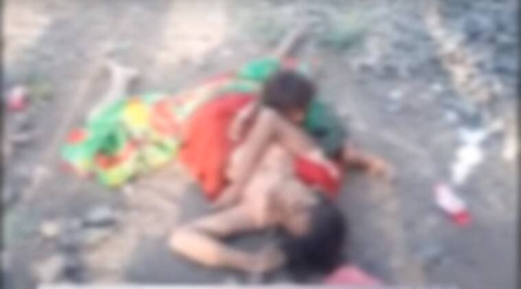 baby sucking dead mother's breast viral video, MP baby suckling to mother's dead body, baby suckling mother's dead body, little boy suckling mother's dead body viral video, trending in india, viral videos, indian express