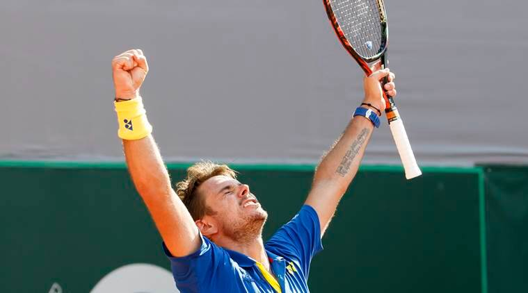 Wawrinka, Nishikori battle into French Open second round