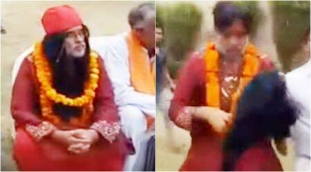 WATCH: Swami Om gets beaten up so badly at Delhi event that his wig comes off