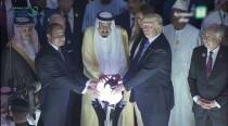 Donald Trump grabbing glowing orb in Saudi Arabia inspires hilarious photo-caption frenzy on Internet