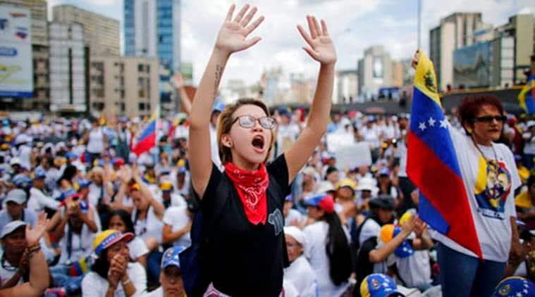 Venezuela, Venezuela Crisis, Venezuela Protest March, Chavez statue, World News, Latest World News, Indian Express, Indian Express News
