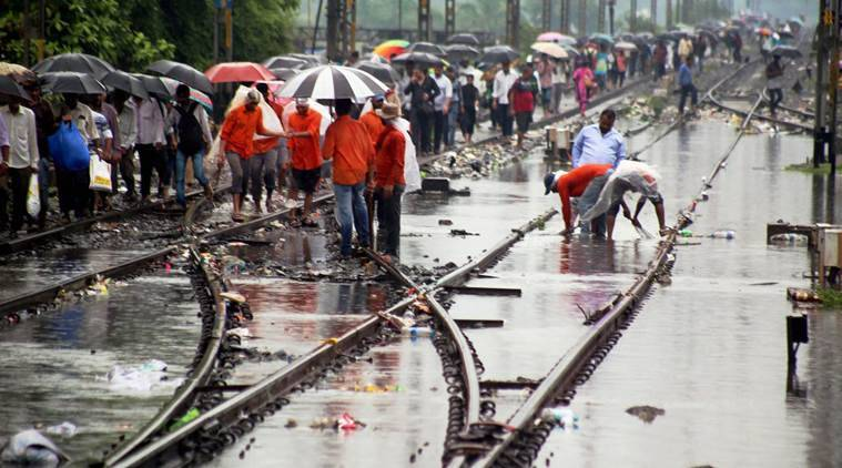 Mumbai Rain, Mumbai Monsoon, Mumbai heavy rain, Local train delayed, Indian express