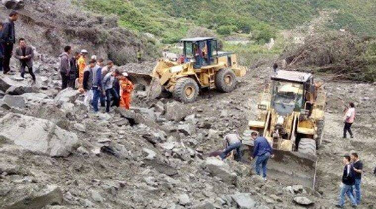 Six killed, over 100 missing as landslide buries mountain
