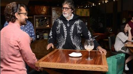 Thugs Of Hindostan actors Amitabh Bachchan and Aamir Khan caught in a candid moment between shoot. What are they talking? See photo