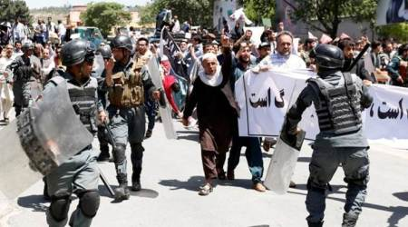 Protesters, angry at Kabul bomb blast, clash with police at anti-government rally inAfghanistan
