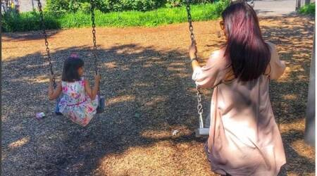 Aishwarya Rai Bachchan, daughter Aaradhya take to swings and Abhishek captures this happy holiday moment. See photo
