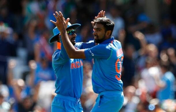 India's Ravichandran Ashwin (R) celebrates the wicket of South Africa's Hashim Amla