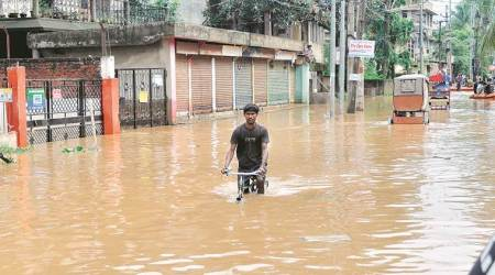 Assam floods, Sarbananda Sonowal, Himanta Biswa Sarma, Guwahati floods, Mission Flood-Free Guwahati, Assam State Disaster Management Authority (ASDMA), indian express news
