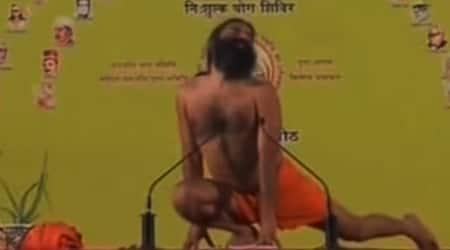 international yoga day, baba ramdev, ramdev doing yoga, famous ramdev baba videos, indian express, indian express news