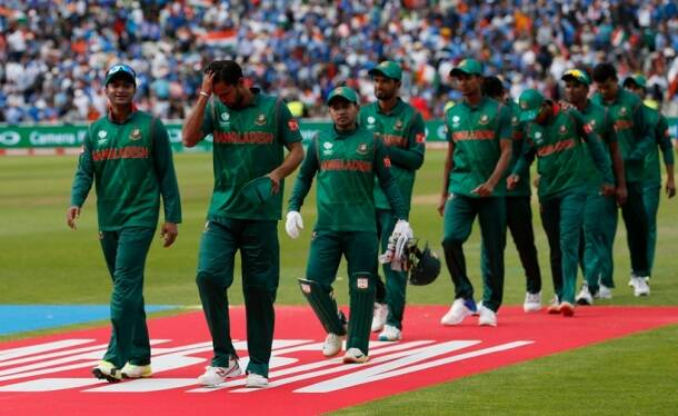 Bangladesh players look dejected after the match