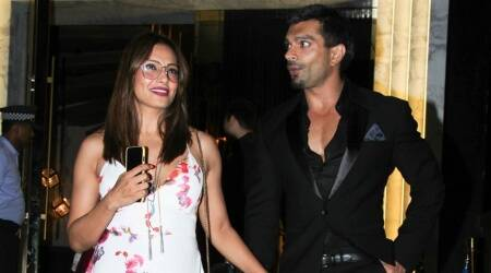 Bipasha Basu's retro look in this floral dress is perfect for monsoon