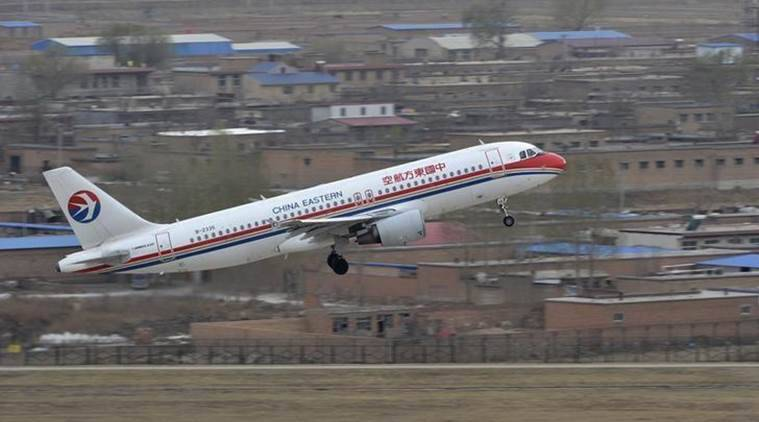 chinese passenger throws coin in plane, coins in plane engine, China coins thrown in plane's engine, Shanghai Pudong International Airport, indian express news