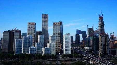 China's Q4 economic growth likely to slow amid debt, pollution battle