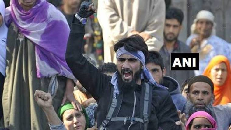 Militant displaying weapons at funeral surrenders