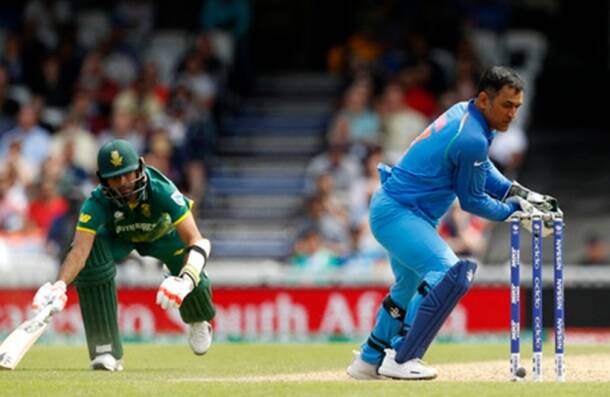 India's MS Dhoni as South Africa's Imran Tahir is run out