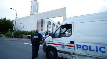 Man held after driving into barriers protecting Paris mosque