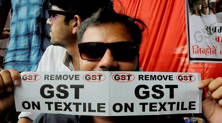 GST, GST protest, GST on textiles, Surat GST protest, Union minister Mansukh Mandaviya, Surat textile traders on GST, indian express news