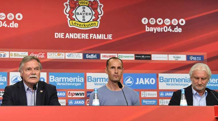 Former Germany player Herrlich takes over Leverkusen
