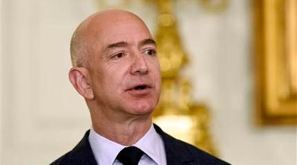 Jeff Bezos becomes richest man in modern history, topping $150 billion