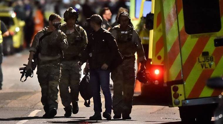 London police arrest 12 in raids after terror attack