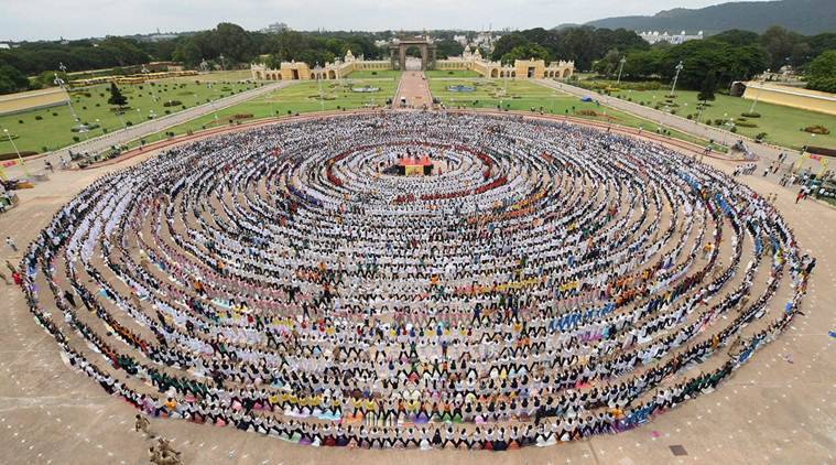 International yoga day 2017 with more than 8000 students india thousands of students create the longest yoga chain for guinness book of world records ahead international yoga day at mysore palace in karnataka on ccuart Gallery