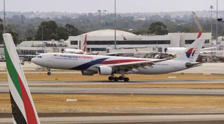 Malaysia Airlines jet turns back after man enters cockpit, threatens to detonate a bomb