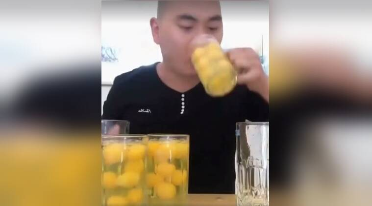 man drinking eggs, man drinking raw eggs in china, viral videos, man drinks 50 eggs in 15 seconds, indian express, indian express news
