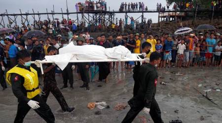 Heavy rains fall as ships, locals search Myanmar crash site