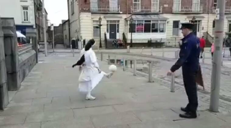 nun playing football, viral video, policemen and nun playing football, funny nun videos, indian express, indian express news