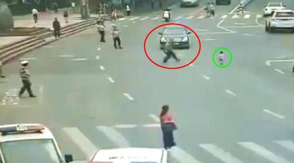 officer in front of car, traffic policeman car save child, cop in front of car to save child, people china twitter, Guizhou, indian express, indian express news