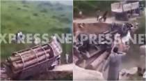 Video: Dramatic moment of overloaded truck overturning in Pakistan caught on camera