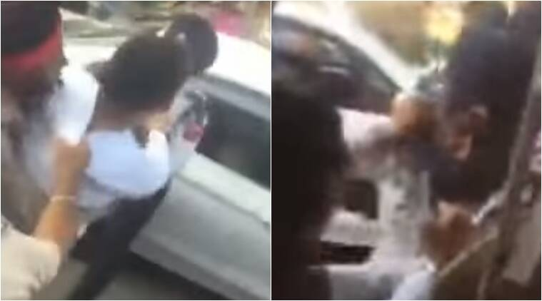 man slaps police officer, man in punjab slaps a police constable, man gets into a fight with a police officer in punjab, himanshu mittal slaps a police officer in punjab, indian express, indian expres news