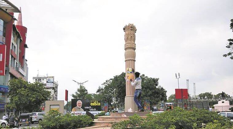 Narendra Modi's visit to Rajkot, BJP workers overdrive, Gujarat Chief Minister Vijay Rupani , Posters on Ashoka Pillar Rajkot, Gujarat News, Indian Express News