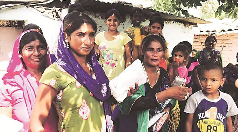 sanitary napkins, slums, india news, indian express news